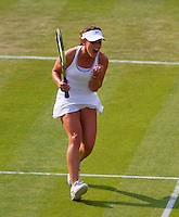26-06-13, England, London,  AELTC, Wimbledon, Tennis, Wimbledon 2013, Day three, Michelle Larcher De Brito(POR) defeats Maria Sharapova and celebrates her victory<br /> <br /> <br /> <br /> Photo: Henk Koster