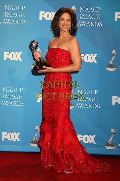 SOLEDAD O'BRIEN.38th Annual NAACP Image Awards at the Shrine Auditorium - Press Room, Los Angeles, California, USA, .2 March 2007..full length red dress  strapless winner trophy.CAP/ADM/BP.©Byron Purvis/AdMedia/Capital Pictures.