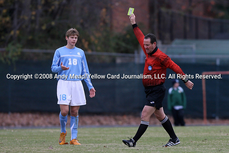 06 December 2008: Referee Lou Labbadia shows a yellow card to North Carolina's Kirk Urso (18). The University of North Carolina Tar Heels defeated the Northwestern University Wildcats 1-0 at Fetzer Field in Chapel Hill, North Carolina in a NCAA Division I Men's Soccer tournament quarterfinal game.