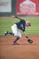Helena Brewers infielder Brice Turang (18) fields a ground ball during a Pioneer League game against the Grand Junction Rockies at Kindrick Legion Field on August 19, 2018 in Helena, Montana. The Grand Junction Rockies defeated the Helena Brewers by a score of 6-1. (Zachary Lucy/Four Seam Images)