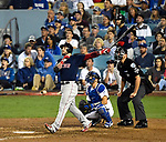 LOS ANGELES, CA - OCTOBER 27: Steve Pearce #25 of the Boston Red Sox hits a solo home run to tie the Dodgers during the eighth inning in Game Four of Major League Baseball's World Series at Dodger Stadium in Los Angeles, California on October 27, 2018. (Photo by Christopher Evans)