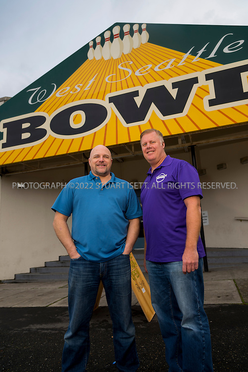 12/18/2013&mdash;Seattle, WA, USA<br /> <br /> Mike Gubsch (right) and Andy Carl (left), owners of West Seattle in Bowl in Seattle, Washington.<br /> <br /> Established August 25, 1948, West Seattle Bowl has become part of the fabric of the West Seattle Community.   The 14 lane center expanded to 32 lanes in 1959.  Upgrades over the years include a state-of-the-art scoring system, new furniture and d&eacute;cor, bumpers for kids on every lane, new synthetic lanes and a private meeting space for 18. The new Highstrike Grill restaurant, added in 2011, has received rave reviews.<br /> <br /> Current owners Michael Gubsch and Andrew Carl have a combined experience of 75 years in the bowling industry.<br /> <br /> Photograph by Stuart Isett. <br /> &copy;2013 Stuart Isett. All rights reserved.