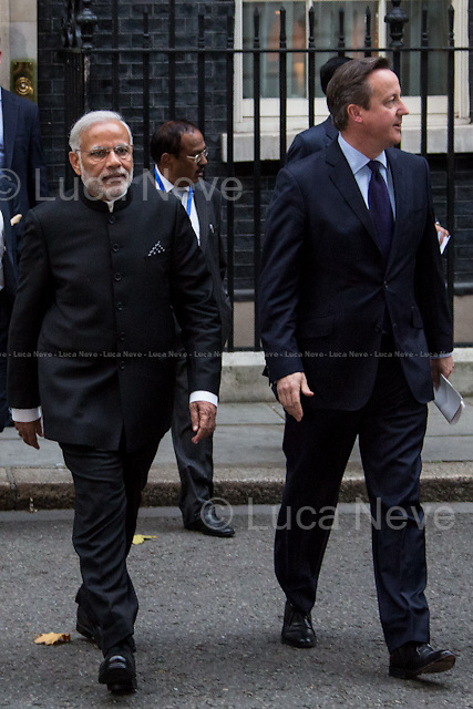 (From L to R) Narendra Modi and David Cameron .<br /> <br />  London, 12/11/2015. Today, the Prime Minister of India Narendra Modi (Leader of the Bharatiya Janata Party, BJP; former Chief Minister of Gujarat from 2001 to 2014; actual Member of Parliament from Varanasi) met the British Prime Minister David Cameron at 10 Downing Street during his visit to the UK. After the meeting, the two Prime Ministers went to Parliament Square (cleared from traffic and members of the public) to pay tribute to the Mahatma Gandhi statue and to see the Red Arrows performing a flypast over Westminster. In the meantime, Sikh and Kashmir people protested patrolled by heavy police presence.