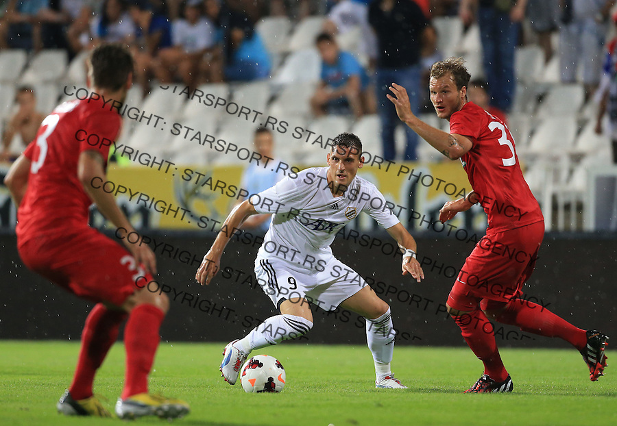Fudbal Football Soccer<br /> UEFA Europa league-Second qualifying round, First leg<br /> Cukaricki v Grodig Austria<br /> Nikola Stoiljkovic (C) and Matthias Maak (R)<br /> Beograd, 07.17.2014.<br /> foto: Srdjan Stevanovic/Starsportphoto &copy;