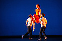 London, UK. 27.11.2013. Mark Morris Dance Group in an extract from Programme A, at Sadler's Wells. Dancers are: Chelsea Lynn Acree, Sam Black, Benjamin Freedman, Brian Lawson, Aaron Loux, Laurel Lynch, Stacy Martorana, Dallas McMurray, Spencer Ramirez, Billy Smith and Noah Vinson. Costume design is by Elizabeth Kurtzman and lighting design by Michael Chybowski. Photograph © Jane Hobson.