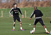 Pictured: Michu (L). Saturday 08 March 2014<br /> Re: Swansea City FC training at the Fairwood Training ground in the outskirts of Swansea, south Wales.