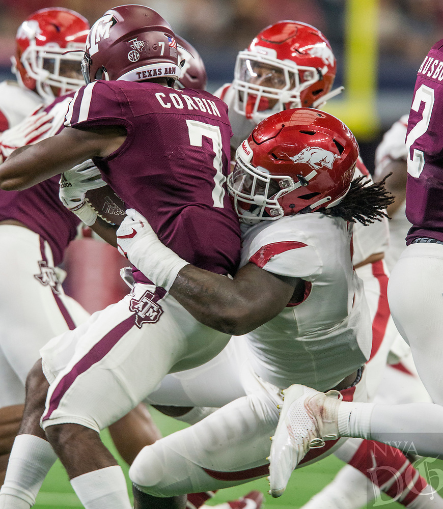 Hawgs Illustrated/Ben Goff<br /> McTelvin Agim, Arkansas defensive end, tackles Jashaun Corbin, Texas A&M running back, in the 1st quarter Saturday, Sept. 29, 2018, during the Southwest Classic at AT&T Stadium in Arlington, Texas.