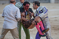 Fernando Cruz is taken to the infirmary  with two serious injured by bull horn  during the  bullfight Virgen de la Paloma festivity