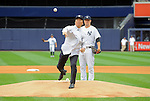 Hideki Matsui,<br /> JULY 28, 2013 - MLB :<br /> Hideki Matsui throws out the ceremonial first pitch as New York Yankees starting pitcher Phil Hughes looks on during Matsui's official retirement ceremony before the Major League Baseball game against the Tampa Bay Rays at Yankee Stadium in The Bronx, New York, United States. (Photo by AFLO)