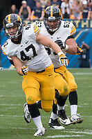 Iowa running back John Kenny (47) and center Austin Blythe (63) look to block someone. Iowa Hawkeyes defeated the Pitt Panthers 24-20 at Heinz Field, Pittsburgh Pennsylvania on September 20, 2014.