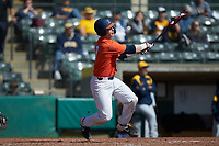 Jacob Campbell (9) of the Illinois Fighting Illini follows through on his swing against the West Virginia Mountaineers at TicketReturn.com Field at Pelicans Ballpark on February 23, 2020 in Myrtle Beach, South Carolina. The Fighting Illini defeated the Mountaineers 2-1.  (Brian Westerholt/Four Seam Images)