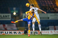 CJ Hamilton of Mansfield Town & Will De Havilland of Wycombe Wanderers during the The Checkatrade Trophy  Quarter Final match between Mansfield Town and Wycombe Wanderers at the One Call Stadium, Mansfield, England on 24 January 2017. Photo by Andy Rowland.