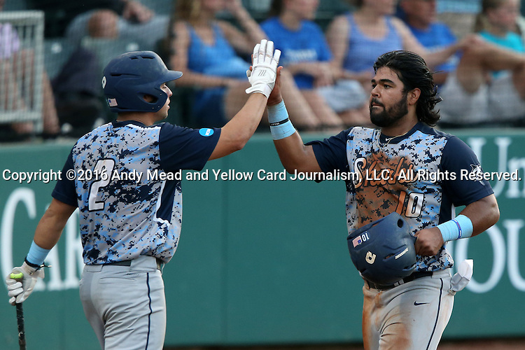 31 May 2016: Nova Southeastern's Andres Visbal (10) celebrates scoring a run with Kavan Thompson (2). The Nova Southeastern University Sharks played the Lander University Bearcats in Game 8 of the 2016 NCAA Division II College World Series  at Coleman Field at the USA Baseball National Training Complex in Cary, North Carolina. Nova Southeastern won the game 12-1.
