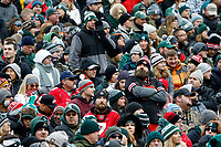 An Ohio State Buckeyes fan listens to jawing from a Michigan State Spartans fan during the second quarter of the NCAA football game at Spartan Stadium in East Lansing, Mich. on Nov. 10, 2018. [Adam Cairns/Dispatch]