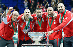 Members of the Serbian national tennis team, from left: Nenad Zimonjic, Janko Tipsarevic, Viktor Troicki, Novak Djokovic and team captain Bogdan Obradovic jubilate after they won the Davis Cup finals against France in Belgrade, Serbia, Sunday, Dec. 5, 2010..(Srdjan Stevanovic/Starsportphoto ©)