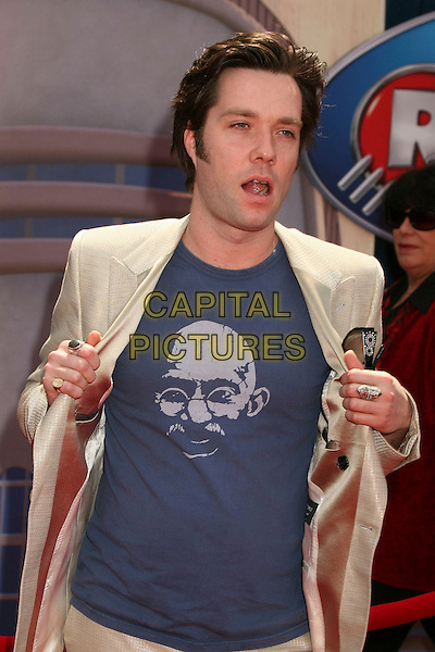 "RUFUS WAINWRIGHT .""Meet The Robinsons"" Los Angeles Premiere at the El Capitan Theatre, Hollywood, California, USA..March 25th, 2007.half length mouth open opening jacket beige suit print blue top.CAP/ADM/BP.©Byron Purvis/AdMedia/Capital Pictures"