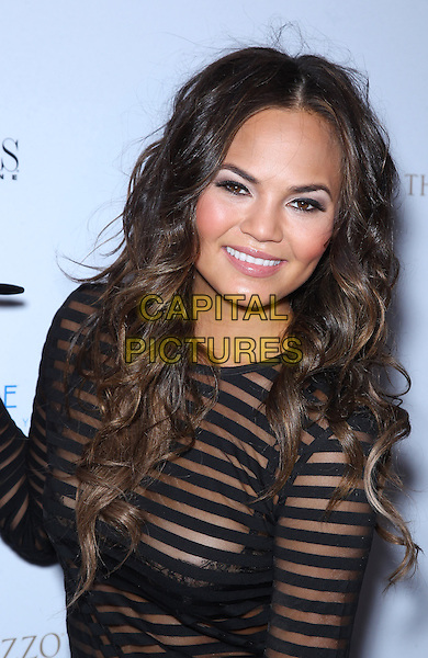 Chrissy Teigen<br /> Vegas Magazine celebrates its summer issue with cover star Chrissy Teigen at Azure Luxury Pool at the Palazzo, Las Vegas, Nevada, USA.<br /> 24th July 2013<br /> half length black sheer stripe to see through thru bra christine    <br /> CAP/ADM/MJT<br /> &copy; MJT/AdMedia/Capital Pictures