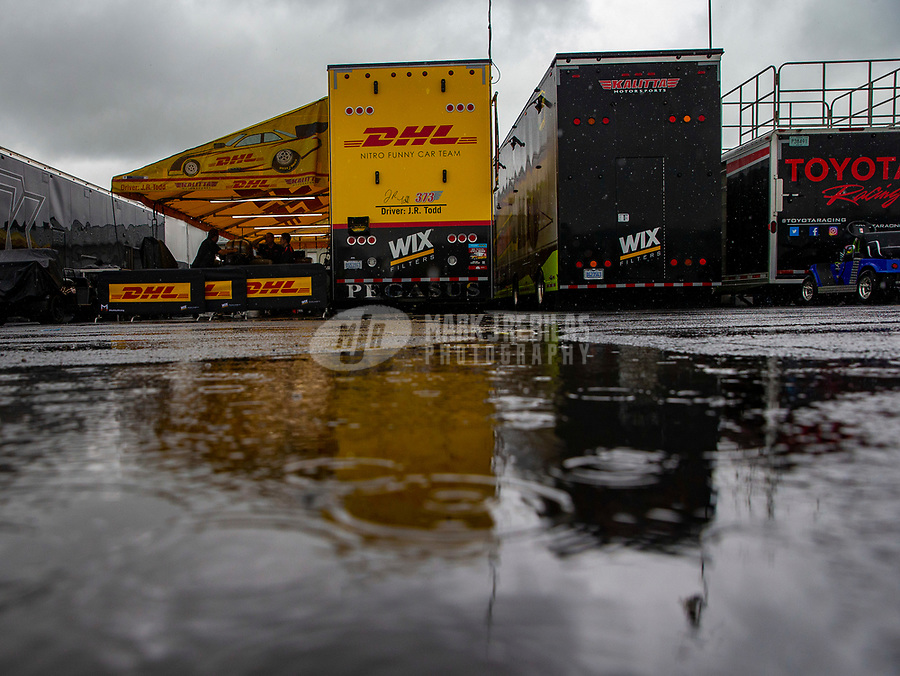 May 20, 2018; Topeka, KS, USA; Rain falls outside the pit area of NHRA funny car driver J.R. Todd during a rain delay to the Heartland Nationals at Heartland Motorsports Park. Mandatory Credit: Mark J. Rebilas-USA TODAY Sports