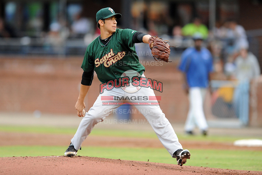 Savannah Sand Gnats starting pitcher Luis Cessa #20 swings at a pitch during a game against the Asheville Tourists at McCormick Field on July 30, 2013 in Asheville, North Carolina. The Sand Gnats won the game 9-5. (Tony Farlow/Four Seam Images)
