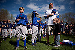 From left, nine-year old Ryan Shell, eight-year old Miles Allen, and coach Bob Benton during the National Anthem at Opening Day of River Park Youth Baseball in Sacramento, Calif., March 12, 2011.