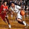 Jabeon Bivins #3 of Baldwin, right, gets pressured by Matt Asenjo #3 of Half Hollow Hills West during the Class AA varsity boys basketball Long Island Championship at LIU Post on Sunday, Mar. 6, 2016. Baldwin outscored Hills West 15-3 in the fourth quarter and won by a score of 65-55.