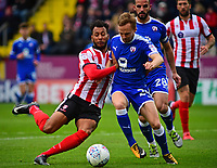 Lincoln City's Matt Green vies for possession with Chesterfield's Andy Kellett<br /> <br /> Photographer Andrew Vaughan/CameraSport<br /> <br /> The EFL Sky Bet League Two - Lincoln City v Chesterfield - Saturday 7th October 2017 - Sincil Bank - Lincoln<br /> <br /> World Copyright &copy; 2017 CameraSport. All rights reserved. 43 Linden Ave. Countesthorpe. Leicester. England. LE8 5PG - Tel: +44 (0) 116 277 4147 - admin@camerasport.com - www.camerasport.com