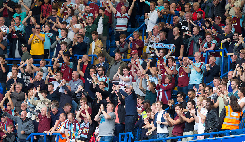 Burnley fans celebrate at full time<br /> <br /> Photographer Craig Mercer/CameraSport<br /> <br /> The Premier League - Chelsea v Burnley - Saturday August 12th 2017 - Stamford Bridge - London<br /> <br /> World Copyright &copy; 2017 CameraSport. All rights reserved. 43 Linden Ave. Countesthorpe. Leicester. England. LE8 5PG - Tel: +44 (0) 116 277 4147 - admin@camerasport.com - www.camerasport.com