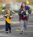 A women and her son bring flowers to put next to a memorial near the scene of a shooting that killed four Lakewood Police Officers in Lakewood on Sunday, Nov. 29, 2009.  At about 8:00 this morning, a gunman walked into the Fornza Coffee shop while the four police officers were having coffee before their shift started and opened fire, killing all our law enforcement..Jim Bryant Photo. ©2010. ALL RIGHTS RESERVED.