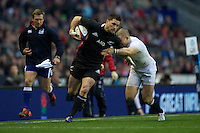 Cory Jane of New Zealand is tackled by Mike Brown of England during the QBE Autumn International match between England and New Zealand at Twickenham on Saturday 01 December 2012 (Photo by Rob Munro)