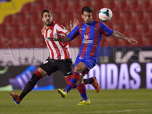 07.04.2014 Valencia, Spain. Defender Mikel Balenziaga of Athletic Bilbao (L) challenges for the ball with Forward Ruben G. of Levante U.D. during the La Liga game Levante UD v Athletic Bilbao at Ciutat de Valencia Stadium, Valencia.