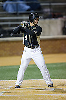 Stuart Fairchild (4) of the Wake Forest Demon Deacons at bat against the Delaware Blue Hens at Wake Forest Baseball Park on February 13, 2015 in Winston-Salem, North Carolina.  The Demon Deacons defeated the Blue Hens 3-2.  (Brian Westerholt/Four Seam Images)