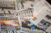 Headlines of several days' New York newspapers on Saturday, January 10, 2014 report on the recent terrorist attacks and murders in Paris. The headquarters of Charlie Hebdo, a satirical magazine, and a kosher supermarket were the seen of murders and hostage taking allegedly by Al Qeada terrorists.  (© Richard B. Levine)