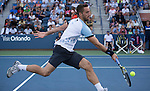 Viktor Troicki (SRB) loses in five sets to Donald Young (USA) 4-6, 06, 7-6, 6-2, 6-4 at the US Open in Flushing, NY on September 5, 2015.