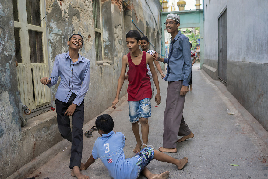 October 29, 2015 - Mandalay (Myanmar). Kids play soccer inside the gates of Sagaing Dan Mosque in Mandalay. Following riots that took place in 2014 based on false accusations and rumors spread by anti-Muslim monk U Wirathu, Muslim compounds in the city are protected by metal gates that are closed and guarded every night. © Thomas Cristofoletti / Ruom