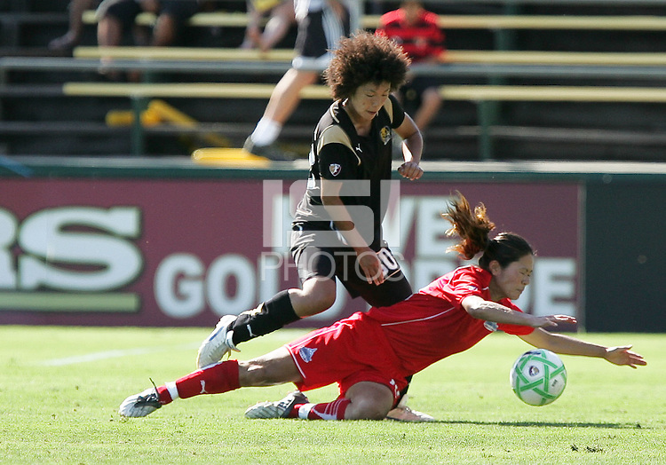 Eriko Arakawa (3) above Homare Sawa. FC Gold Pride defeated Washington Freedom 3-2 at Buck Shaw Stadium in Santa Clara, California on August 1, 2009.