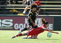Eriko Arakawa (3) above Homare Sawa. FC Gold Pride defeated Washington Freedom 3-2 at Buck Shaw Stadium in Santa Clara, California on August 1, 2009.