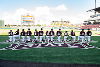 Mississippi State baseball players watch the Florida Gators warm up before one of the Bulldogs' three victories over the No. 1 ranked Gators. The sweep marked the end of the regular season, but postseason play will begin Tuesday [May 22] when the Bulldogs take on Louisiana State University in the SEC Tournament. In addition to sweeping Florida, MSU also recognized graduating baseball players and managers with a special ceremomy held at home plate of Dudy Noble Field.<br />  (photo by Megan Bean / &copy; Mississippi State University)
