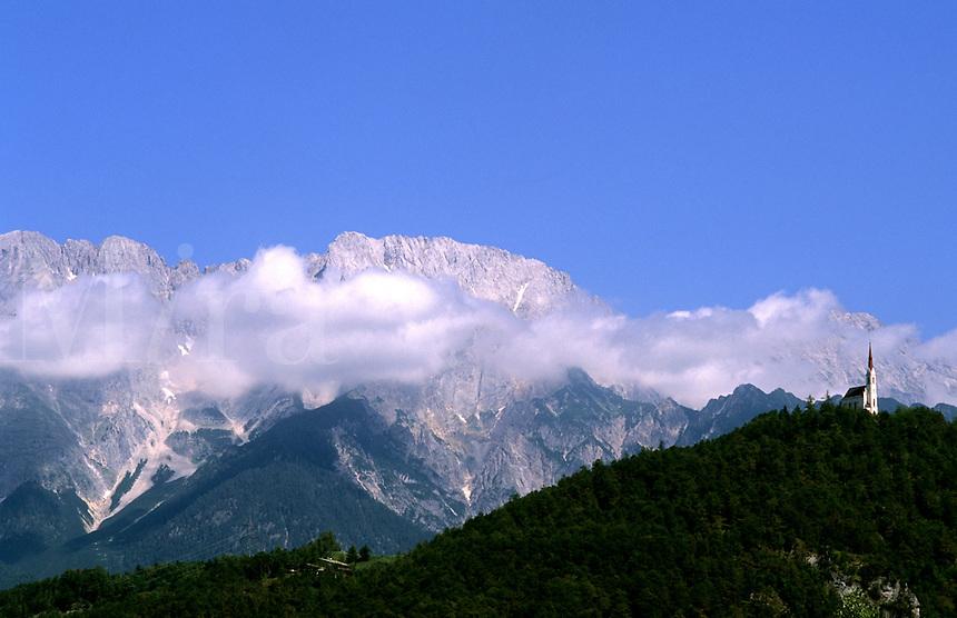 Steeple on top of steep mountain near Innsbruck, Austria