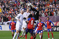 Costa Rica goalkeeper Keilor Navas (1) goes up to defend the play against USMNT midfielder Michael Bradley (4)    The USMNT tied Costa Rica 2-2 on the final game of the 2010  FIFA World Cup Qualifying round at RFK Stadium,Wednesday  October 14 , 2009.