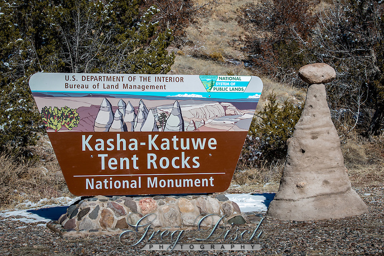 Kasha-Katuwe Tent Rocks National Monument on the Pajarito Plateau in north-central New Mexico, includes a national recreation trail and ranges from 5,570 feet to 6,760 feet above sea level.  It is for foot travel only, and contains two segments that provide opportunities for hiking, birdwatching, geologic observation, and plant identification.<br /> <br /> The cone-shaped tent rock formations are the products of volcanic eruptions that occurred 6 to 7 million years ago and left pumice, ash, and tuff deposits over 1,000 feet thick.  Tremendous explosions from the Jemez volcanic field spewed pyroclasts (rock fragments), while searing hot gases blasted down slopes in an incandescent avalanche called a &ldquo;pyroclastic flow.&rdquo;<br /> <br /> Precariously perched on many of the tapering hoodoos are boulder caps that protect the softer pumice and tuff below.  Some tents have lost their hard, resistant caprocks, and are disintegrating.  While fairly uniform in shape, the tent rock formations vary in height from a few feet up to 90 feet.
