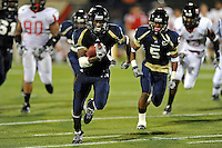 27 November 2010:  FIU's T.Y. Hilton (4) takes a Wesley Carroll pass 42 yards for a touchdown with 1:42 left in the game as the FIU Golden Panthers defeated the Arkansas State Red Wolves, 31-24, at FIU Stadium in Miami, Florida.