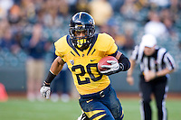 November 12th, 2011:  Isi Sofele of California runs down the field during a game against Oregon State at AT&T Park in San Francisco, Ca  -  California defeated Oregon State 23 - 6
