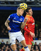 23rd  November 2019; Goodison Park , Liverpool, Merseyside, England; English Premier League Football, Everton versus Norwich City; Lucas Digne of Everton and Kenny McLean of Norwich City compete for the ball in the air - Strictly Editorial Use Only. No use with unauthorized audio, video, data, fixture lists, club/league logos or 'live' services. Online in-match use limited to 120 images, no video emulation. No use in betting, games or single club/league/player publications