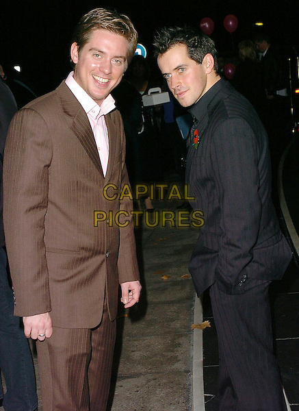 RICHARD MCCOURT & DOMINIC WOOD.Closer's Young Heroes 2005- Award Ceremony held at The Dorchester, London..UK, United Kingdom..15th November 2005..Ref: CAN.3/4 length with together Dick Dom brown black pinstripe suit.www.capitalpictures.com.sales@capitalpictures.com.©Capital Pictures