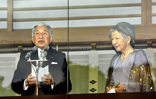 December 23, 2013, Tokyo, Japan - Japan's emperor Akihito reads a statement as he receives well-wishers celebrating his 80th birthday during a genreral audiencre at the Imperial Palace in Tokyo on Monday, December 23, 2013. Akihito told the crowd of some 25,000 people that he prayed the coming year will be a good year for all. Empress Michiko is at right. (Photo by Natsuki Sakai/AFLO)