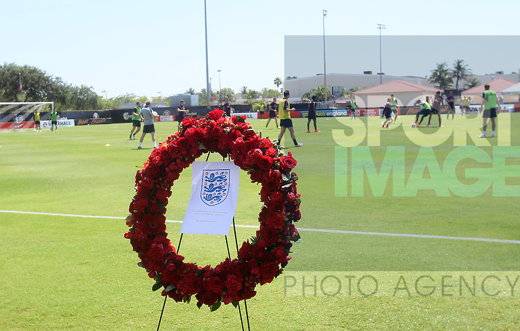 England's players train with a wreath on the side of the pitch to commemorate the 70th anniversary of the D-Day landings<br /> <br /> England Training &amp; Press Conference  - Barry University - Miami - USA - 06/06/2014  - Pic David Klein/Sportimage