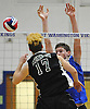 Owen Bradley #17 of Bellmore JFK, left, tries to spike as Daniel Dash #28 of Port Washington defends against the hit during a Nassau County varsity boys volleyball match at Port Washington High School on Monday, Oct. 17, 2016. Port Washington won in straight sets; 25-23, 25-21, 25-15.