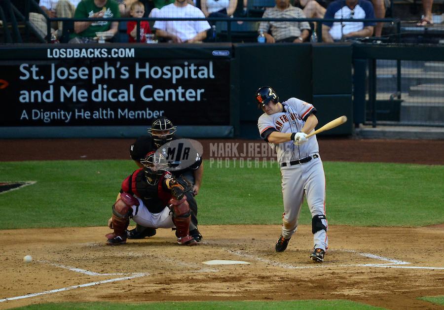 May 12, 2012; Phoenix, AZ, USA; San Francisco Giants pitcher Matt Cain hits a two RBI double in the sixth inning against the Arizona Diamondbacks at Chase Field. Mandatory Credit: Mark J. Rebilas-