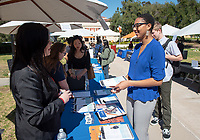 Ayanna Lynch '20 at the F.B.I. booth.<br /> Occidental College Career Services hosts the Career Fair, open to all students seeking full-time, professional jobs and internships, in the AGC quad on Feb. 19, 2019.<br /> (Photo by Marc Campos, Occidental College Photographer)