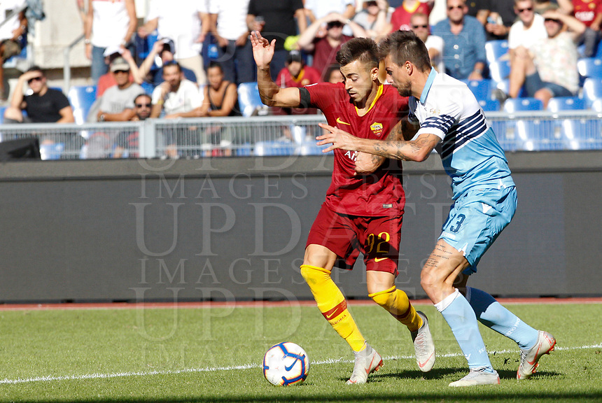 Roma's Stephan El Shaarawy, left, is challenged by Lazio's Francesco Acerbi during the Italian Serie A football match between Roma and Lazio at Rome's Olympic stadium, September 29, 2018. Roma won 3-1.<br /> UPDATE IMAGES PRESS/Riccardo De Luca